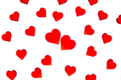 Bright red hearts on a striped background with two red hearts. In order to use Valentine`s Day, weddings, International Women`s Da Stock Photos