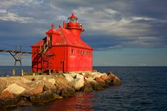 Bright red historic light house. Red Great Lakes Lighthouse in evening light Stock Images