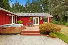 Bright red house with walkout deck and patio area Stock Images