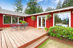 Bright red house with walkout deck and patio area Royalty Free Stock Photography