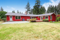 Bright red house with walkout deck and patio area Stock Photography