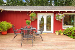 Bright red house with walkout deck and patio area Royalty Free Stock Photo