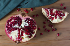 Bright red and juicy pomegranate on a table Royalty Free Stock Photo