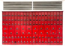 Bright red letter boxes on the wall Stock Photos