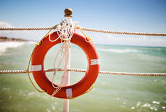 Bright red lifebuoy. On the pier Royalty Free Stock Image