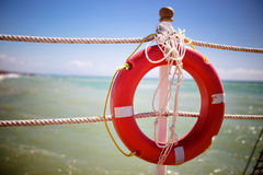 Bright red lifebuoy. On the pier Royalty Free Stock Photography