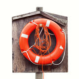 Bright red lifebuoy in wooden case isolated. On white Royalty Free Stock Image