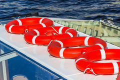 Bright red lifebuoys. On the boat Stock Photography