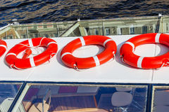 Bright red lifebuoys. On the boat in sunny day Stock Photo
