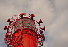 Bright red lighthouse Stock Photography