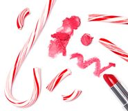 Bright red lipstick with crushed Christmas candy Stock Photos