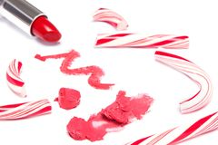 Bright red lipstick with crushed Christmas candy Royalty Free Stock Photos