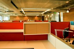 Bright red office cubes. Red cube walls mark the low rise office cubicles in this ultra modern office design in Portland Stock Photography