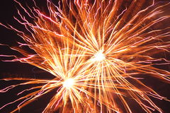 Bright red and orange fireworks Stock Image