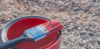 Ckise up on bright red paint in can and brush. Bright red paint can brush color   chore painting upkeep ckise stock images