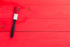 Bright red painted wooden surface with brush Stock Photos