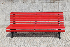 Bright red park bench Stock Photo