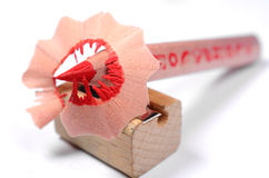 Bright red pencil with knife-sharpener Royalty Free Stock Image