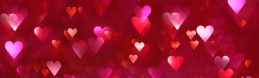 Bright red and pink hearts abstract background. Bright red and pink hearts abstract bokeh background Stock Photography