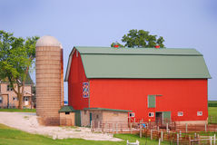 A bright red quilt barn with a silo in rural Wisconsin. Stock Photos