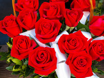 Bright red roses in basket Royalty Free Stock Photo