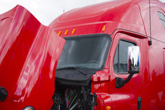 Bright red semi truck cab with open hood Stock Image