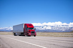Bright Red Semi Truck Modern Transportation On Spectacular Highway Stock Images