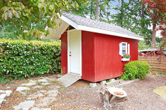 Bright red shed on backyard area Royalty Free Stock Images