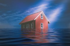 Bright Red Siding House in water flood. Blue sky background royalty free stock photos