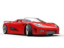 Bright red sports car on white background. Left view Stock Photos