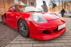 Bright red sporty styled Toyota MR-S car stands parked Stock Images