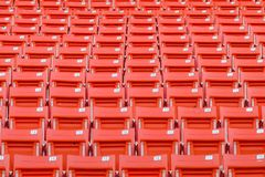 Bright red stadium seats Stock Photography