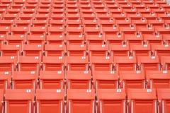 Bright red stadium seats Stock Image