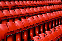 Bright red stadium seats Royalty Free Stock Photo