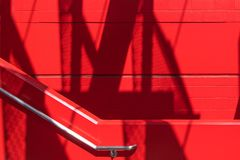 Free Bright Red Staircase Wall, Concrete Block Wall And Stainless Steel Hand Rail In A Modern Structure Royalty Free Stock Photos - 160475808