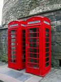 Old Telephone Booths at Edinburgh Castle, Scotland. The bright red telephone boxes are an iconic sight in Great Britain, though they have become distinctively Stock Photos