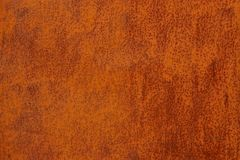 Bright red texture of a piece of rusty metal Royalty Free Stock Photos