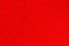 Bright red textured background. The bright red textured background Stock Photo