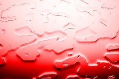 Bright red textured background, spilled bloody color water drops or red liquid illustration, abstract blots pattern close up macro royalty free stock image