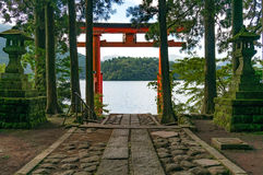 Bright red Torii gate on the lake Ashi royalty free stock photography