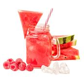 Watermelon smoothie in a mason jar decorated with a slice of watermelon, raspberries and ice cubes isolated on white background. f stock images