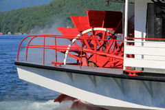 Bright red wheel of steamboat Stock Photography