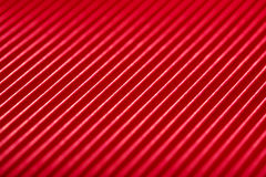Bright red with white diagonal stripes paper texture Royalty Free Stock Images