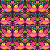Bright red and yellow birds on dark background. Vector seamless pattern in folkloric style Royalty Free Stock Photography