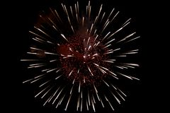 Bright red-yellow explosion of fireworks. stock photos