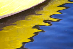 Bright reflections of a fishing boat. Royalty Free Stock Photo
