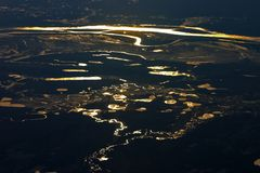 Bright reflections in river and water. Bright reflections in rivers and waters, seen from a flying airplane in the night Stock Photos