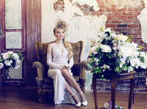 Bright retro bride in luxury interiors with elegant hairstyle an Royalty Free Stock Image