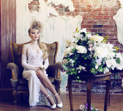 Bright retro bride in luxury interiors with elegant hairstyle an Stock Image