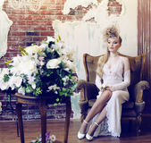 Bright retro bride in luxury interiors with elegant hairstyle an Royalty Free Stock Images